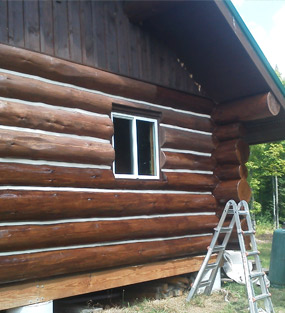 log-cabin-siding-restoration-before-and-after