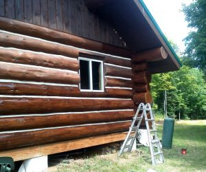 log-cabin-before-and-after-cleaning-siding