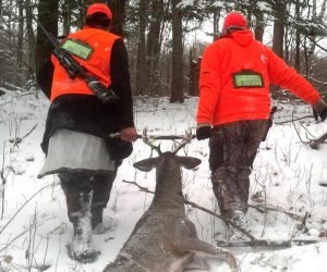 hunters-dragging-buck-out-of-woods