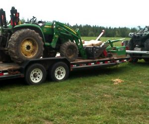 tractor-loaded-on-trailer