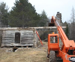 historic-log-cabin-roof-removed-view-of-lift-equipment