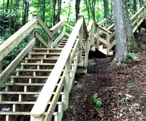 long-winding-outdoor-staircase-down-hill-to-lake