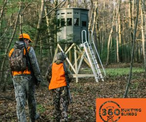 father-son-walking-to-their-360-deer-hunting-blind-with-rifles