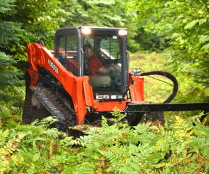 skid-steer-and-attachment-used-for-brush-control